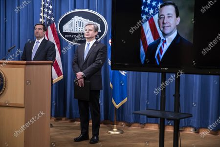 Stock Image of Assistant Attorney General for National Security John C. Demers, left, FBI Director Christopher Wray and Acting U.S. Attorney for the Eastern District of New York Seth DuCharme, pictured on screen as he attends virtually, participate in a news conference at the Department of Justice in Washington, DC, USA, 28 October 2020. Eight people have been arrested in connection to 'Operation Fox Hunt' an effort by China to threaten and coerce Chinese nationals viewed as threats to the regime to return to the country.
