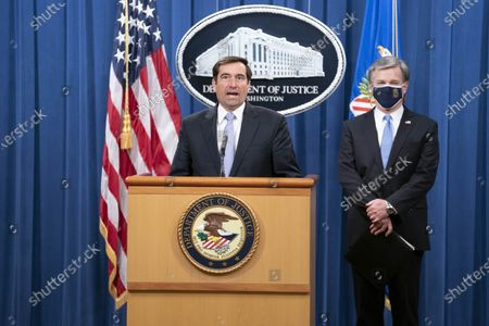 Assistant Attorney General for National Security John C. Demers, left, and FBI Director Christopher Wray participate in a virtual news conference at the Department of Justice in Washington, DC, USA, 28 October 2020. Eight people have been arrested in connection to 'Operation Fox Hunt' an effort by China to threaten and coerce Chinese nationals viewed as threats to the regime to return to the country.