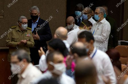 Cuba's President Miguel Diaz-Canel, top, second from left, follows former president Raul Castro inside the National Assembly in Havana, Cuba, . Lawmakers are expected to debate new economic measures for the island in the coming year, including currency reform and measures to encourage tourism and private business
