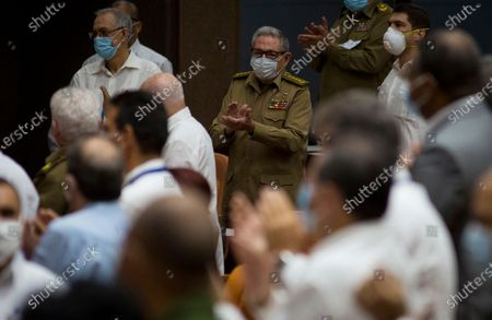 Former Cuban President Raul Castro applauds during a session of the National Assembly in Havana, Cuba, . Lawmakers are expected to debate new economic measures for the island in the coming year, including currency reform and measures to encourage tourism and private business