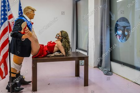 Donald Trump caricature in a compromising position with Miss America - a satirical artwork by Alison Jackson at the Soho Revue Gallery.