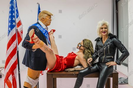 Stock Picture of Donald Trump caricature in a compromising position with Miss America - a satirical artwork by Alison Jackson at the Soho Revue Gallery.