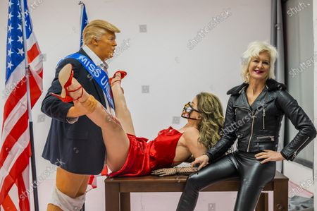 Stock Photo of Donald Trump caricature in a compromising position with Miss America - a satirical artwork by Alison Jackson at the Soho Revue Gallery.