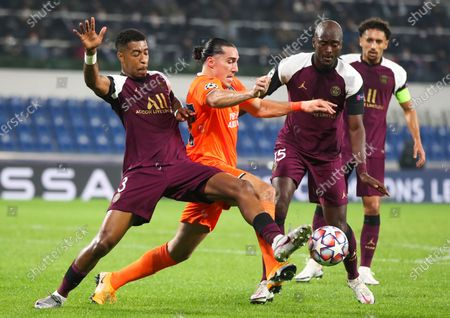 Enzo Crivelli (2-L) of Basaksehir in action against Presnel Kimpembe (L) of PSG during the UEFA Champions League group H soccer match between Istanbul Basaksehir and Paris Saint-Germain in Istanbul, Turkey, 28 October 2020.