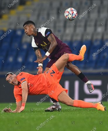 Enzo Crivelli (bottom) of Basaksehir in action against Presnel Kimpembe (up) of PSG during the UEFA Champions League group H soccer match between Istanbul Basaksehir and Paris Saint-Germain in Istanbul, Turkey, 28 October 2020.