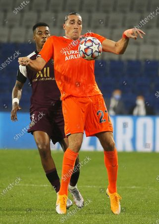 Enzo Crivelli (front) of Basaksehir in action against Presnel Kimpembe of PSG during the UEFA Champions League group H match between Istanbul Basaksehir and Paris Saint-Germain in Istanbul, Turkey 28 October 2020.