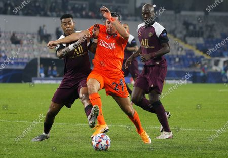 Enzo Crivelli (C) of Basaksehir in action against Presnel Kimpembe (L) of PSG during the UEFA Champions League group H match between Istanbul Basaksehir and Paris Saint-Germain in Istanbul, Turkey 28 October 2020.