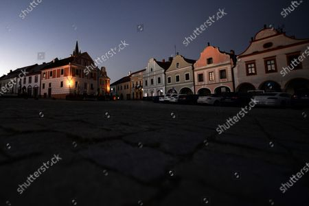 Morning view on the empty square in Telc. The town in southern Moravia, near Jihlava, in the Czech Republic. Baroque houses with high gables and arcades, since 1992 all of this has been a UNESCO World Heritage Site.