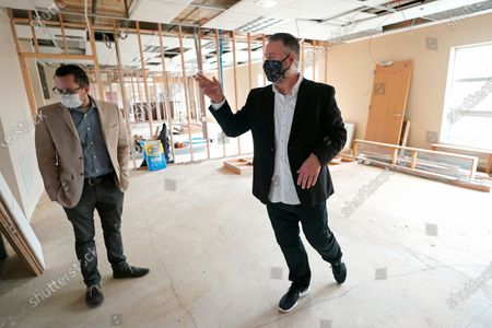 Scott Canfield, left, and Garth Reeves, co-founders of the Why Not You Academy charter school, stand in what will be a classroom, inside the building being renovated to house the school in Des Moines, Wash., south of Seattle. Seattle Seahawks NFL football quarterback Russell Wilson and his Grammy-winning wife, pop singer Ciara, are putting their money and celebrity behind rebranding the charter school, which advocates hope will boost the troubled Washington state charter school sector that has suffered from enrollment problems after years of legal challenges