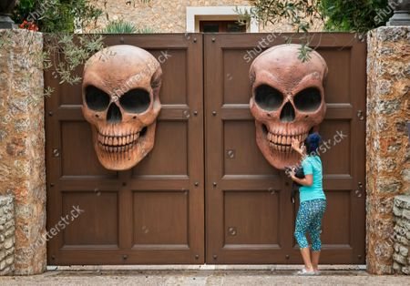 Stock Image of Liz Johnson of West L.A. gets a closer look at Halloween decorations at the entrance to a home on Crescenda St. in Brentwood. (Mel Melcon/Los Angeles Times)