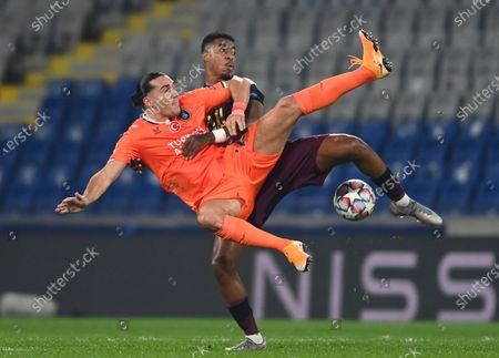 Basaksehir's Enzo Crivelli, left, and PSG's Presnel Kimpembe fight for the ball during the Champions League group H soccer match between Basaksehir and Paris Saint Germain in Istanbul, . Paris Saint Germain won the match 2-0