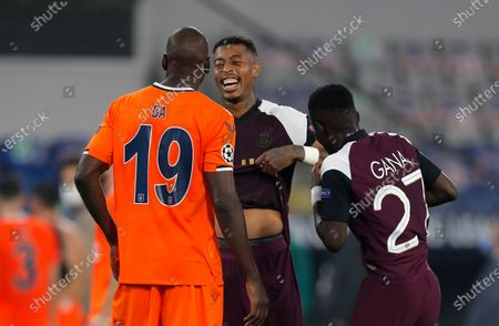 Basaksehir's Demba Ba, left, speaks with PSG's Presnel Kimpembe, centre, and PSG's Idrissa Gueye at the end of the Champions League group H soccer match between Istanbul Basaksehir and Paris Saint Germain at the Fatih Terim stadium in Istanbul