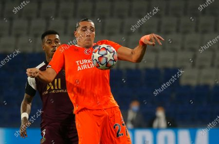 Basaksehir's Enzo Crivelli, right, duels for the ball with PSG's Presnel Kimpembe during the Champions League group H soccer match between Istanbul Basaksehir and Paris Saint Germain at the Fatih Terim stadium in Istanbul
