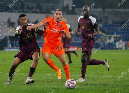 Basaksehir's Enzo Crivelli, centre, duels for the ball with PSG's Presnel Kimpembe during the Champions League group H soccer match between Istanbul Basaksehir and Paris Saint Germain at the Fatih Terim stadium in Istanbul