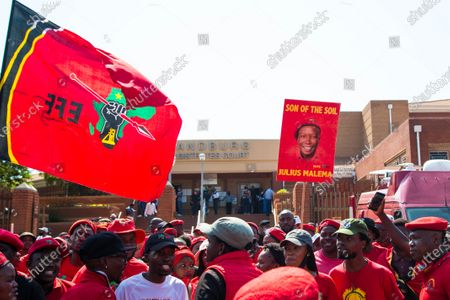 A supporter holding a placard with an image of Julius Malema during the appearing. Julius Malema and the party's MP Mbuyiseni Ndlozi appear in Randburg Magistrate Court, on allegations that they assaulted a policeman.