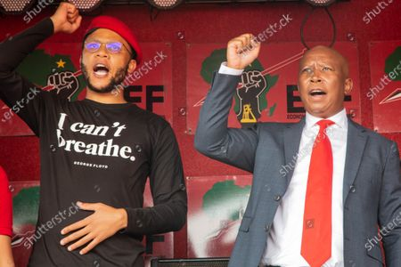 The Economic Freedom Fighters (EFF) spokesperson Vuyani Pambo (L) and Julius Malema gesturing during the appearing. Julius Malema and the party's MP Mbuyiseni Ndlozi appear in Randburg Magistrate Court, on allegations that they assaulted a policeman.
