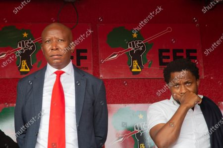 The Economic Freedom Fighters (EFF) MP Mbuyiseni Ndlozi and Julius Malema (L) seen during the appearing. Julius Malema and the party's MP Mbuyiseni Ndlozi appear in Randburg Magistrate Court, on allegations that they assaulted a policeman.