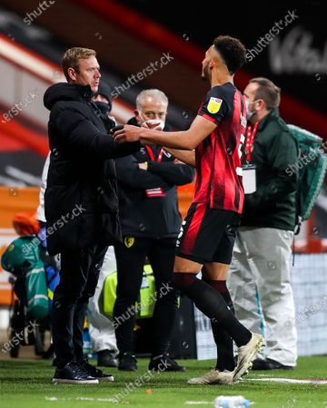 Stock Image of Bristol City head coach Dean Holden and former Bristol City player Lloyd Kelly of Bournemouth after Bournemouth win 1-0