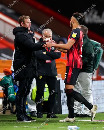 Bristol City head coach Dean Holden and former Bristol City player Lloyd Kelly of Bournemouth after Bournemouth win 1-0
