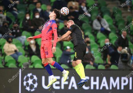 Chelsea's Kai Havertz, left, and Krasnodar's Yury Gazinsky challenge for the ball during the Champions League Group E soccer match between Krasnodar and Chelsea in Krasnodar, Russia