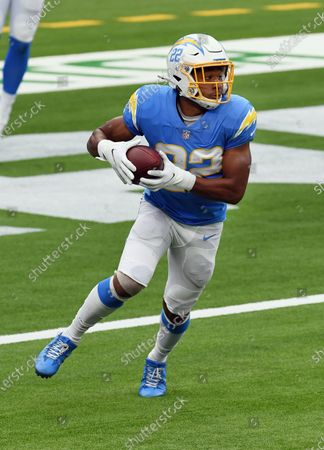 Los Angeles Chargers running back Justin Jackson (22) gains yards after catching a pass during an NFL football game against the Jacksonville Jaguars, in Inglewood, Calif. The Chargers defeated the Jaguars 39-29