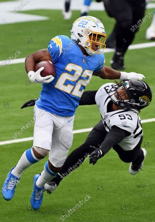 Los Angeles Chargers running back Justin Jackson (22) avoids being tackled by Jacksonville Jaguars line backer Dakota Allen (53) after Jackson caught a pass during an NFL football game, in Inglewood, Calif. The Chargers defeated the Jaguars 39-29
