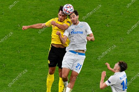 Zenit's Aleksandr Yerokhin, right, and Dortmund's Mats Hummels challenge for the ball the Champions League group F soccer match between Borussia Dortmund and Zenit Saint Petersburg in Dortmund, Germany