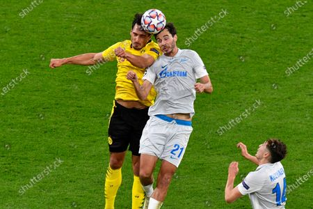 Dortmund's Mats Hummels (L) in action against Zenit's Aleksandr Yerokhin (C) during the UEFA Champions League group F soccer match between Borussia Dortmund and FC Zenit St.Petersburg in Dortmund, Germany, 28 October 2020.
