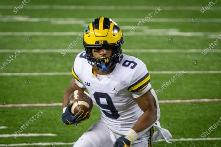 Michigan running back Chris Evans rushes for a touchdown against Minnesota in the fourth quarter of an NCAA college football game, in Minneapolis. Michigan won 49-24