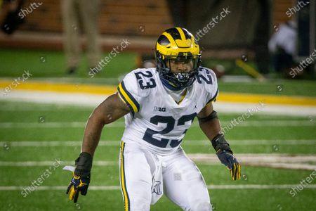 Michigan linebacker Michael Barrett defends against Minnesota in the fourth quarter of an NCAA college football game, in Minneapolis. Michigan won 49-24