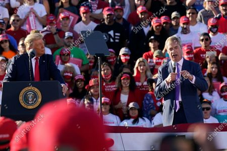 With President Donald Trump looking, left, Nigel Farage, a former member of the European Parliament representing the UK and member of the Brexit Party, speaks at a Trump campaign rally at Phoenix Goodyear Airport, in Goodyear, Ariz