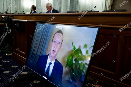 CEO of Facebook Mark Zuckerberg appears on a monitor as he testifies remotely during the Senate Commerce, Science, and Transportation Committee hearing 'Does Section 230's Sweeping Immunity Enable Big Tech Bad Behavior?', on Capitol Hill in Washington, DC, USA, 28. CEO of Twitter Jack Dorsey; CEO of Alphabet Inc. and its subsidiary Google LLC, Sundar Pichai; and CEO of Facebook Mark Zuckerberg all testified virtually at the hearing. Section 230 of the Communications Decency Act guarantees that tech companies can not be sued for content on their platforms, but the Justice Department has suggested limiting this legislation.