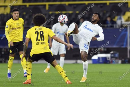 Dortmund's Axel Witsel and Zenit's Wendel, right, challenge for the ball during the Champions League group F soccer match between Borussia Dortmund and Zenit Saint Petersburg in Dortmund, Germany