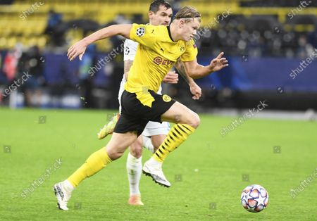 Stock Photo of Dortmund's Erling Haland, front, and Zenits Dejan Lovren fight for the ball during the Champions League group F soccer match between Borussia Dortmund and Zenit Saint Petersburg in Dortmund, Germany