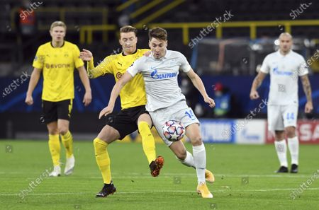 Dortmund's Marco Reus, center left, and Zenit's Daler Kuzyaev, center right, challenge for the ball during the Champions League group F soccer match between Borussia Dortmund and Zenit Saint Petersburg in Dortmund, Germany
