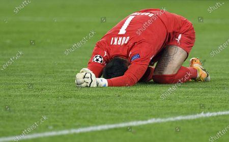 Dortmund goalkeeper Roman Buerki kneels on the pitch during the Champions League group F soccer match between Borussia Dortmund and Zenit Saint Petersburg in Dortmund, Germany