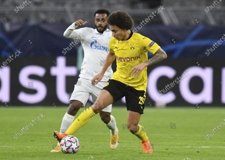 Dortmund's Axel Witsel, right, and Zenits Wendel, left, challenge for the ball during the Champions League group F soccer match between Borussia Dortmund and Zenit Saint Petersburg in Dortmund, Germany
