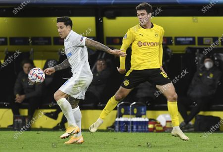 Dortmund's Giovanni Reyna, right, and Zenits Sebastian Driussi, left, challenge for the ball during the Champions League group F soccer match between Borussia Dortmund and Zenit Saint Petersburg in Dortmund, Germany