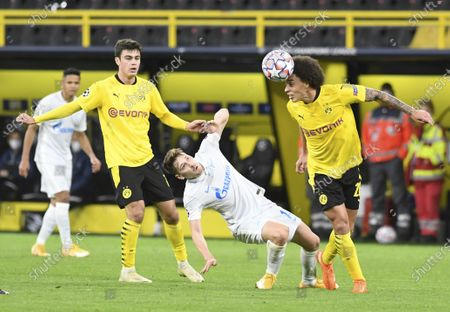 Dortmund's Axel Witsel, right, heads the in front of Zenit's Daler Kuzyaev, center, during the Champions League group F soccer match between Borussia Dortmund and Zenit Saint Petersburg in Dortmund, Germany