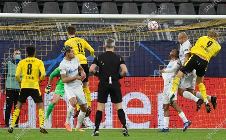 Dortmund's Erling Haland, right, heads the ball during the Champions League group F soccer match between Borussia Dortmund and Zenit Saint Petersburg in Dortmund, Germany