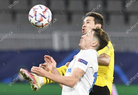 Dortmund's Rapha'l Guerreiro and Zenits Daler Kuzyaev, front, challenge for the ball during the Champions League group F soccer match between Borussia Dortmund and Zenit Saint Petersburg in Dortmund, Germany