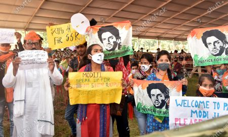 Stock Picture of Sushant Singh Rajput fans hold placards as they demand justice during during an NDA campaign rally for Bihar Assembly Elections, at Veterinary ground on October 28, 2020 in Patna, India.