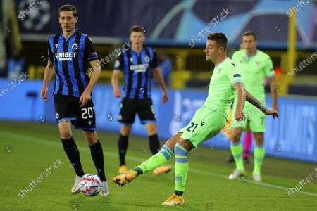 Lazio's Sergej Milinkovic-Savic, right, plays the ball next to Brugge's Hans Vanaken during the Champions League Group F soccer match between Brugge and Lazio at the Jan Breydel stadium in Bruges, Belgium