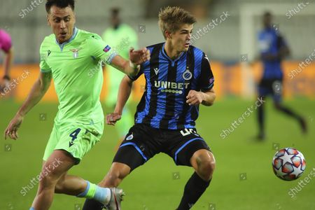 Brugge's Charles De Ketelaere, right, vies for the ball with Lazio's Patric during the Champions League Group F soccer match between Brugge and Lazio at the Jan Breydel stadium in Bruges, Belgium