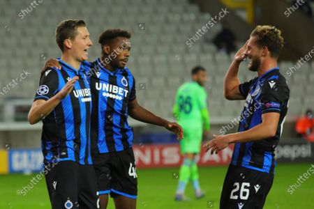 Brugge's Hans Vanaken, left, celebrates with teammates Brugge's Emmanuel Bonaventure, center, and Brugge's Mats Rits after scoring his side's first goal during the Champions League Group F soccer match between Brugge and Lazio at the Jan Breydel stadium in Bruges, Belgium