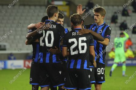 Brugge's Hans Vanaken, left, celebrates with teammates after scoring his side's first goal during the Champions League Group F soccer match between Brugge and Lazio at the Jan Breydel stadium in Bruges, Belgium