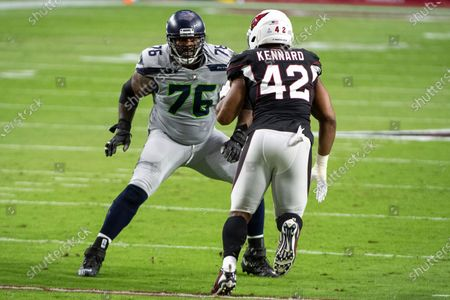 Seattle Seahawks offensive tackle Duane Brown (76) guards Arizona Cardinals outside linebacker Devon Kennard (42) during an NFL football game, in Glendale, Ariz