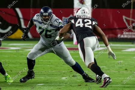 Seattle Seahawks offensive tackle Duane Brown (76) in action against Arizona Cardinals outside linebacker Devon Kennard (42) during an NFL football game, in Glendale, Ariz