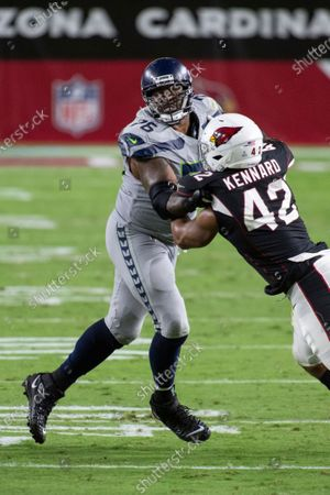 Seattle Seahawks offensive tackle Duane Brown (76) blocks Arizona Cardinals outside linebacker Devon Kennard (42) during an NFL football game, in Glendale, Ariz. The Arizona Cardinals won in overtime