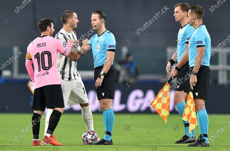 Juventus' Leonardo Bonucci (2-L) and Barcelona's Lionel Messi (L) greet referee Danny Makkelie at the end of the UEFA Champions Legue soccer match between Juventus FC and FC Barcelona, in Turin, Italy, 28 October 2020.